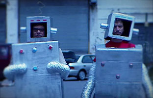 A Photo of the Flight of the Conchords in Robot Costumes